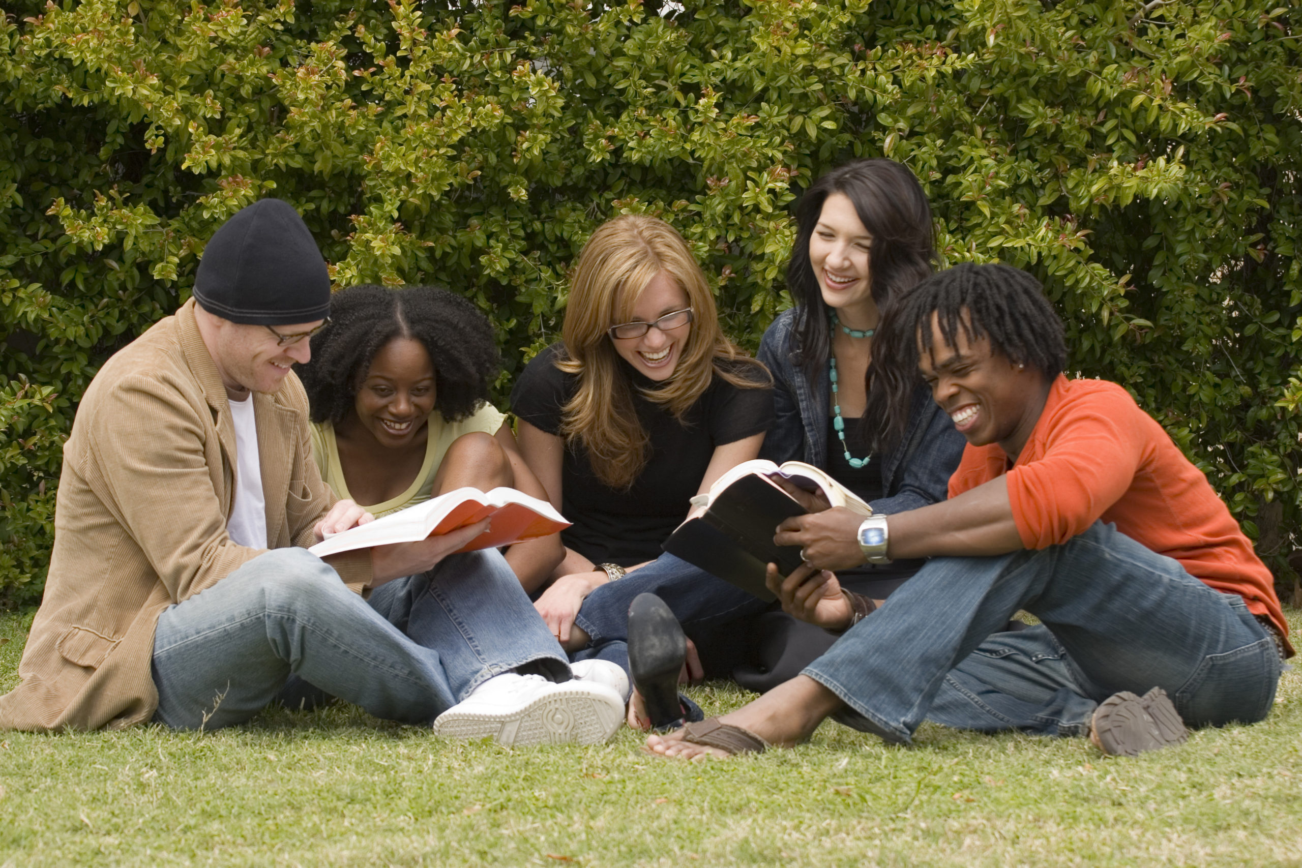 Diverse group of students reading and studying.